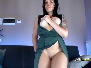 european tattooed milf does a striptease