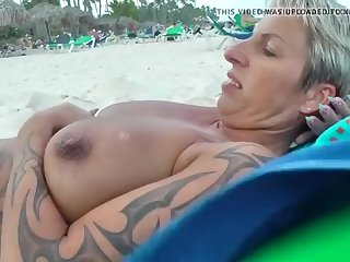beautiful mature pawg relaxing on beach with huge nipples
